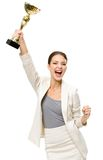 Stående av den lyckliga affärskvinnan med den guld- koppen Royaltyfria Bilder