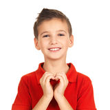 Stående av den lyckliga pojken med en hjärtaform Arkivbild