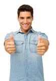 Stående av den stiliga mannen som gör en gest upp tummar Fotografering för Bildbyråer