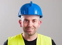 Stående av en arbetare som uttrycker positivity Arkivfoto