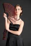 Stående av en flicka med två fans Royaltyfria Foton