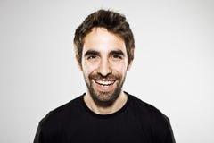 Stående av en normal pojke som skrattar på vit Arkivfoton
