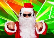 Stående av en Santa Listening Music Royaltyfri Foto