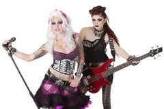 Stående av punkrockmusikbandet över vit bakgrund Fotografering för Bildbyråer