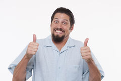 Ståenden av en lycklig visning för ung man tummar upp Arkivfoto