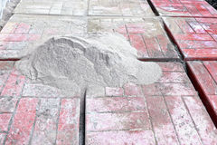 Stenditura delle lastre per pavimentazione Fotografia Stock