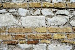 Stenen en bakstenen muur Stock Afbeelding