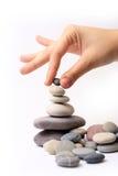 Stenen en hand Stock Foto's