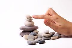 Stenen en hand Stock Afbeeldingen