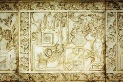 Stenen för traditionell kines inristar konstväggen. Royaltyfri Fotografi
