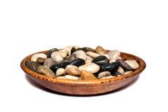Stenen in houten kom Royalty-vrije Stock Foto's