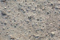 Stenen och sand texturerar nära upp att efterapa månen royaltyfri fotografi