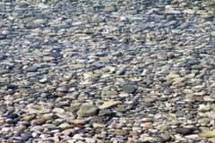Stenen onder het water Stock Afbeelding