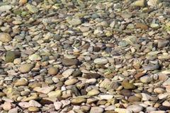 Stenen onder het water Stock Fotografie