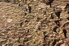 Stenen onder water stock afbeelding