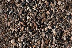 Stenen op verschillende kleuren/textuurachtergrond Royalty-vrije Stock Afbeeldingen