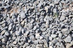 Stenen van grijs graniet in massa stock foto's