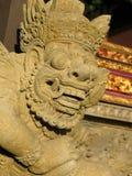 Stenförebilden i templet av den Bali ön arkivfoto
