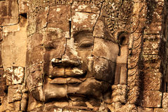 Stenframsida på den Bayon templet, Cambodja Arkivfoton