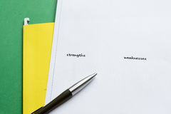 Stength and weakness. White paper with resume - list of strengths and weaknesses Royalty Free Stock Images