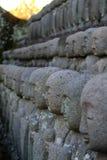 Stenhantverket av munkstatyn Arkivbild