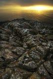 Stenig kust av Wales på soluppgång Royaltyfria Bilder