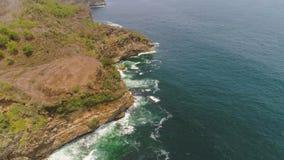 Stenig kust med havbränning stock video