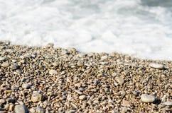 Stenig sand för kust Arkivfoto