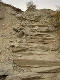 stenig trappuppgång Arkivfoto