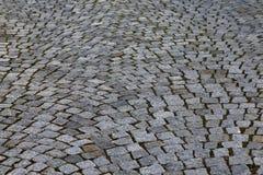 Stenläggningstenar och yttersidor arkivfoton