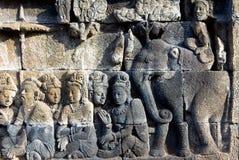 Stenlättnad, tempel Borobudur Royaltyfri Bild