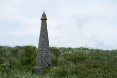 Stenobelisk på ön av hermen Royaltyfri Bild