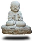 Stenstaty av den buddistiska munken på vit Royaltyfri Foto