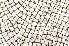 Stenstenläggningtextur/abstrakt begreppgatabakgrund Arkivbild