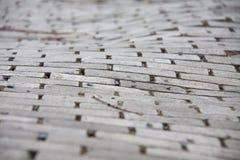 Stentrottoargata av ojämna förberedande stenar Royaltyfri Foto