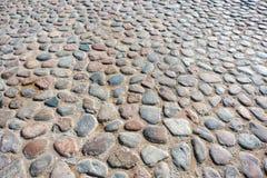 Stentrottoartextur Abstrakt bakgrund av kullerstentrottoar Kullerstentextur - hård trottoar, en sort av trottoar Royaltyfri Fotografi