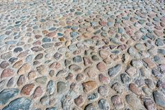 Stentrottoartextur Abstrakt bakgrund av kullerstentrottoar Kullerstentextur - hård trottoar, en sort av trottoar Royaltyfria Foton