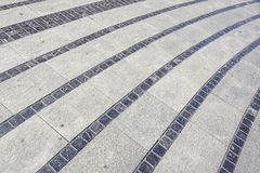 Stentrottoartextur Bakgrund för trottoar för granitkullersten asfull Abstrakt bakgrund av gammal kullerstentrottoar Arkivfoton