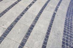 Stentrottoartextur Bakgrund för trottoar för granitkullersten asfull Abstrakt bakgrund av gammal kullerstentrottoar Royaltyfria Foton