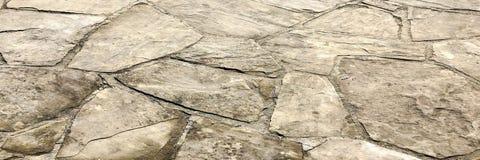 Stentrottoartextur cobblestoned granittrottoar för bakgrund Abstrakt bakgrund av den gamla kullerstentrottoarnärbilden Seamle royaltyfri foto