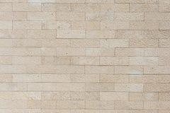 Stenväggen belägger med tegel Arkivfoto