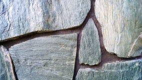 Stenväggen texturerar bakgrund Arkivfoto