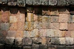 Stenväggen texturerar på Phanom ringde det forntida tempelet i thailändska Buriram Arkivfoton
