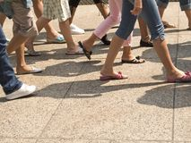 In Step. This is a shot of lots of legs walking in the city Royalty Free Stock Images