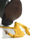 Step on it. Man walking about ot step on a banana peel Royalty Free Stock Photography