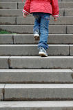 STEP. A child climbs step by step Stock Photos