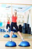 Step aerobics. Young sporty woman in the gym centre Stock Photo