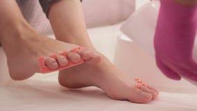 Step of applying gel polish in pedicure stock video