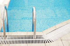 Step in the blue pool water. A step in the blue pool water royalty free stock photos