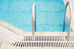 Step in the blue pool water. A step in the blue pool water royalty free stock photo